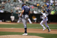 Tampa Bay Rays starting pitcher Tyler Glasnow (20) stands on the mound as Oakland Athletics' Oakland Athletics' Austin Allen, right, rounds the bases after hitting a solo home run during the second inning of a baseball game Saturday, May 8, 2021, in Oakland, Calif. (AP Photo/Tony Avelar)