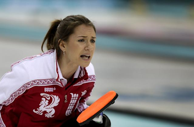 Russia's skip Alexandra Saitova shouts instructions to her teammates during the women's curling competition against Denmark at the 2014 Winter Olympics, Monday, Feb. 10, 2014, in Sochi, Russia. (AP Photo/Wong Maye-E)