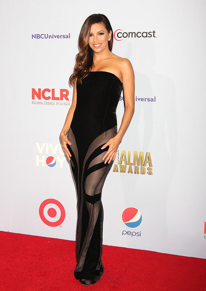 """Eva Longoria looked surprisingly statuesque at the 2012 ALMA Awards thanks to this strapless Alberta Ferretti showstopper, which featured velvet accents and sheer paneling. What do you make of the former """"Desperate Housewives"""" star's ensemble? Hot or not? (9/17/2012)<br><br><a target=""""_blank"""" href=""""http://bit.ly/lifeontheMlist"""">Follow 2 Hot 2 Handle creator, Matt Whitfield, on Twitter!</a>"""