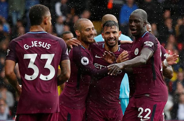 <p>Manchester City's Sergio Aguero celebrates scoring their second goal with team mates Action Images via Reuters/John Sibley </p>