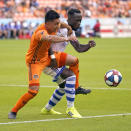 Houston Dynamo's Memo Rodriguez, left, battles Montreal Impact's Bacary Sagna for the ball during the first half of an MLS soccer match Saturday, March 9, 2019, in Houston. (AP Photo/David J. Phillip)