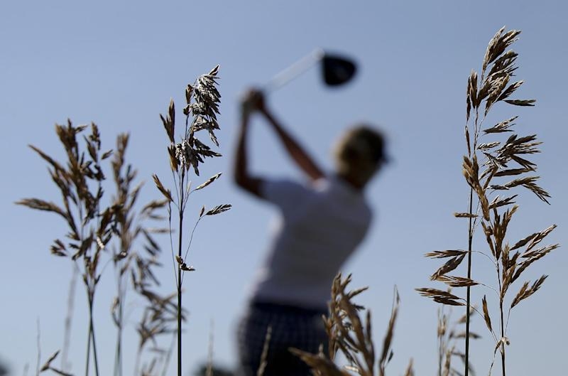 Giulia Sergas from Italy watches her tee shot on the 11th hole during a practice round for the Solheim Cup golf tournament, Thursday, Aug. 15, 2013, in Parker, Colo. (AP Photo/Chris Carlson)