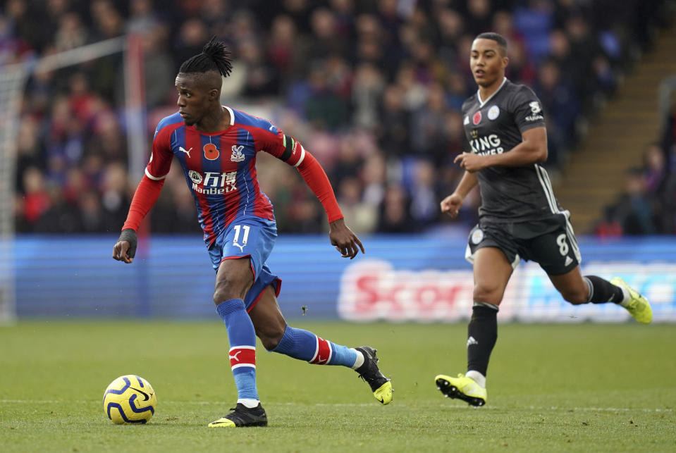 Crystal Palace's Wilfried Zaha, left, breaks from Leicester City's Youri Tielemans during the English Premier League soccer match at Selhurst Park, London, Sunday Nov. 3, 2019. (John Walton/PA via AP)