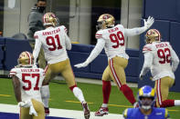 San Francisco 49ers defensive tackle Javon Kinlaw (99) celebrates in the end zone after returning an interception for a touchdown during the second half of an NFL football game Sunday, Nov. 29, 2020, in Inglewood, Calif. (AP Photo/Alex Gallardo)