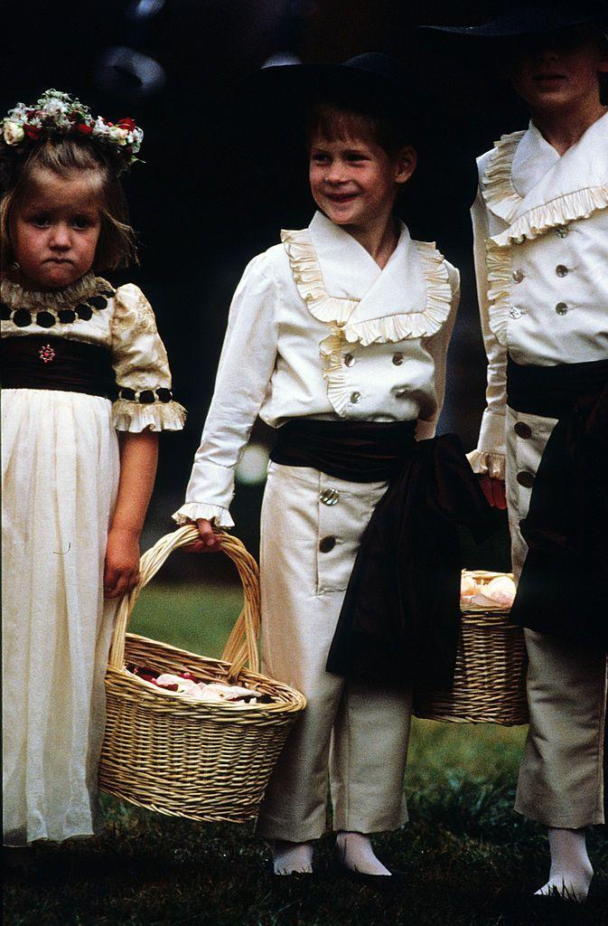 <p>Prince Harry performs the role of pageboy at the wedding of his uncle, Viscount Althorp, on September 17. Here, he's with his cousins Eleanor and Alexander Fellowes. </p>