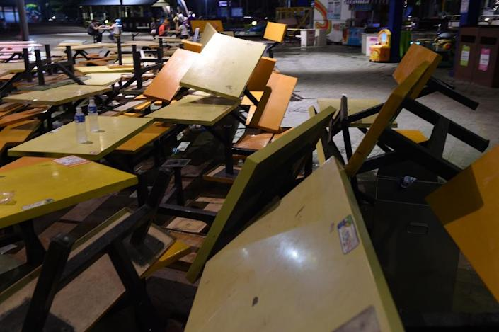 Overturned tables lie on the ground at the Formosa Fun Coast amusement park after an explosion in the Pali district of New Taipei City early June 28, 2015 (AFP Photo/Sam Yeh)