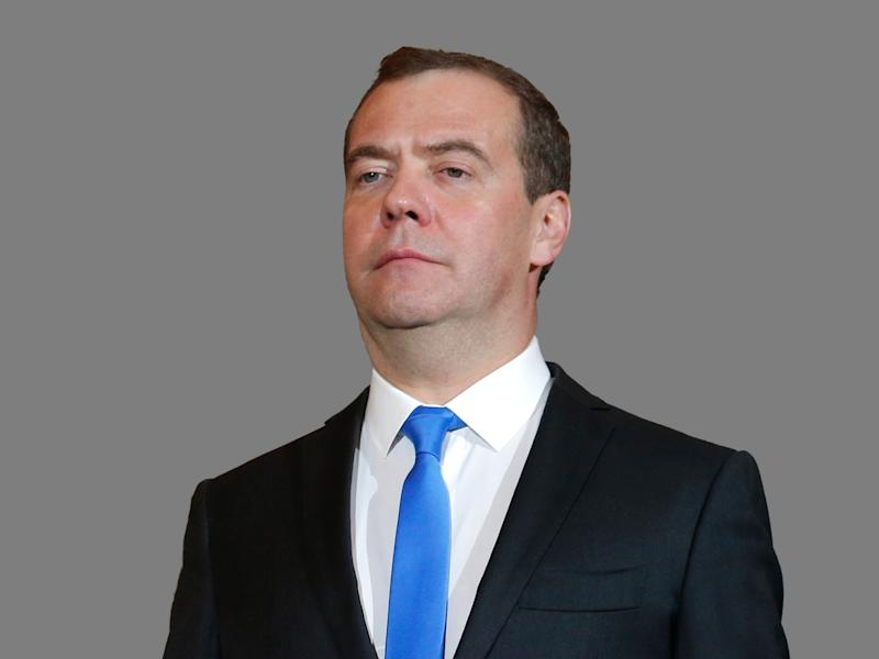Dmitry Medvedev headshot, as Russia Prime Minister, graphic element on gray