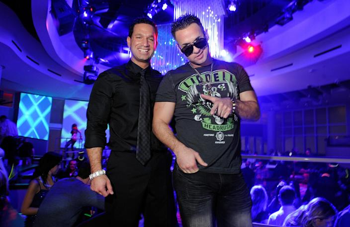"""Marc Sorrentino, left, and Mike """"The Situation"""" Sorrentino, right, at a nightclub in Las Vegas on Feb. 14, 2012. (David Becker via Getty Images)"""