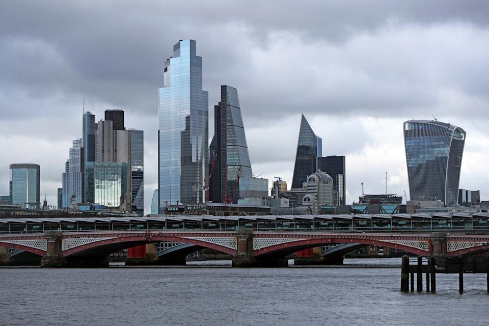 A general view of the buildings in London's primary financial district behind the River Thames.