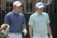 Rory McIlroy, left, of Northern Ireland, and Matthew Fitzpatrick, of England, share a laugh while waiting to his their tee shots on the first hole during the final round of the Arnold Palmer Invitational golf tournament Sunday, March 10, 2019, in Orlando, Fla. (AP Photo/Phelan M. Ebenhack)