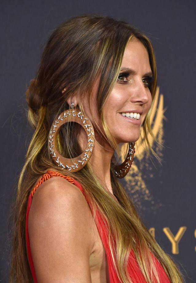 Heidi Klum's hoops were so big, they grazed her shoulders. (Photo: Getty Images)