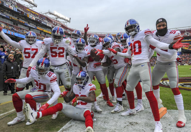 <p>New York Giants free safety Curtis Riley (35) celebrates with the rest of the defensive unit after intercepting a pass and returning it nine yards for a touchdown in the first quarter against the Washington Redskins on December 9, 2018, at FedEx Field in Landover, MD. (Photo by Mark Goldman/Icon Sportswire) </p>