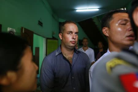 Phil Blackwood, a bar manager from New Zealand, comes out of court after being sentenced to two and half years in prison, at Bahan township court in Yangon