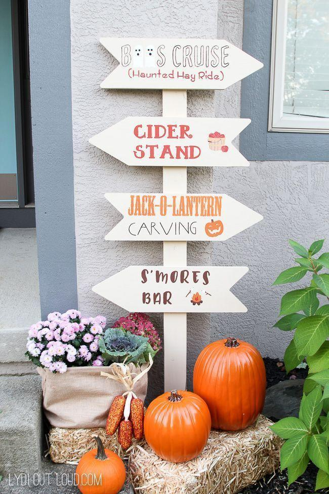 """<p>There are so many fun ways to use a DIY yard sign! You could follow this blogger's lead and highlight your favorite autumnal memories—pumpkin carving, drinking cider, making s'mores—or add the names and locations of long-distance family members.</p><p><strong>See more at <a href=""""https://lydioutloud.com/fall-festival-sign-fall-porch-decor/"""" rel=""""nofollow noopener"""" target=""""_blank"""" data-ylk=""""slk:Lydi Out Loud"""" class=""""link rapid-noclick-resp"""">Lydi Out Loud</a>.</strong></p><p><strong><a class=""""link rapid-noclick-resp"""" href=""""https://go.redirectingat.com?id=74968X1596630&url=https%3A%2F%2Fwww.walmart.com%2Fsearch%2F%3Fquery%3Dcraft%2Bpaint&sref=https%3A%2F%2Fwww.thepioneerwoman.com%2Fhome-lifestyle%2Fdecorating-ideas%2Fg36732301%2Foutdoor-fall-decorations%2F"""" rel=""""nofollow noopener"""" target=""""_blank"""" data-ylk=""""slk:SHOP CRAFT PAINT"""">SHOP CRAFT PAINT</a></strong></p>"""