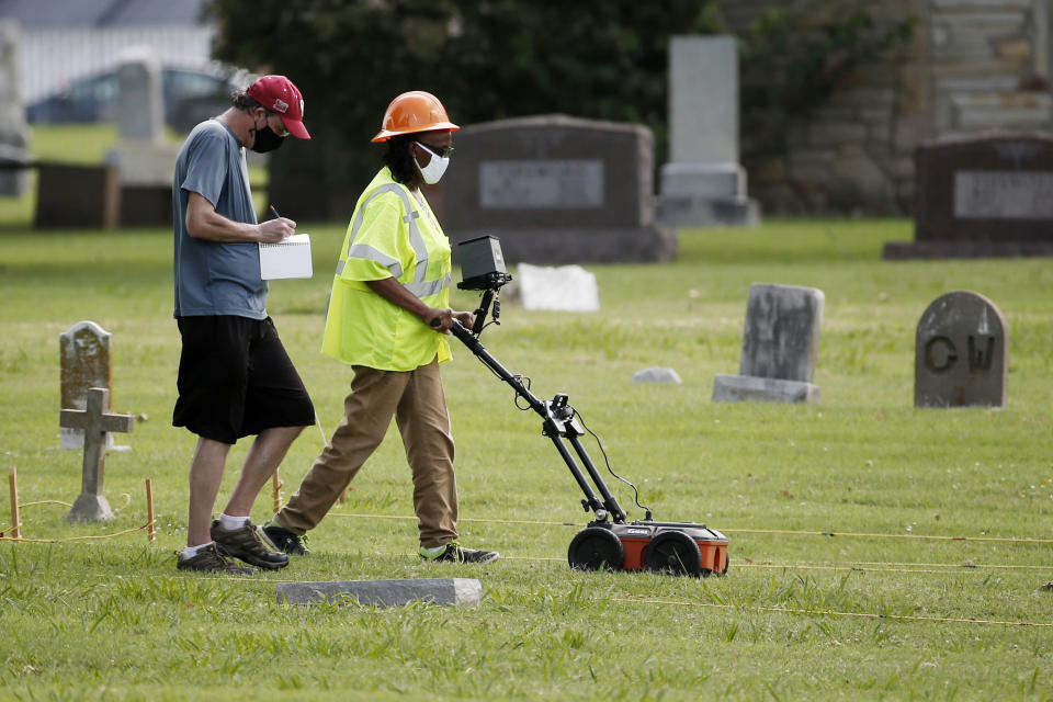 FILE - In this July 17, 2020, file photo, workers use ground penetrating radar to search for a potential unmarked mass grave from the 1921 Tulsa Race Massacre, at Oaklawn Cemetery in Tulsa, Okla. As the U.S. marks 100 years since one of its most shameful historical chapters, researchers, including descendants of Black victims of the Tulsa Race Massacre, are preparing to resume a search for remains believed to have been hastily buried in mass graves. (AP Photo/Sue Ogrocki File)