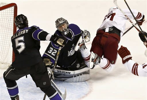 Los Angeles Kings' Jonathan Quick (32) reacts to a goal by Phoenix Coyotes' Raffi Torres, right, as Kings' Keaton Ellerby (5) skates nearby during the second period of an NHL hockey game Tuesday, March 12, 2013, in Glendale, Ariz. (AP Photo/Ross D. Franklin)