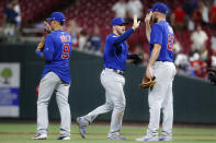 Chicago Cubs center fielder Ian Happ, center, celebrates with shortstop Javier Baez (9) and relief pitcher Kyle Ryan (56) after the team's baseball game against the Cincinnati Reds, Thursday, Aug. 8, 2019, in Cincinnati. (AP Photo/John Minchillo)
