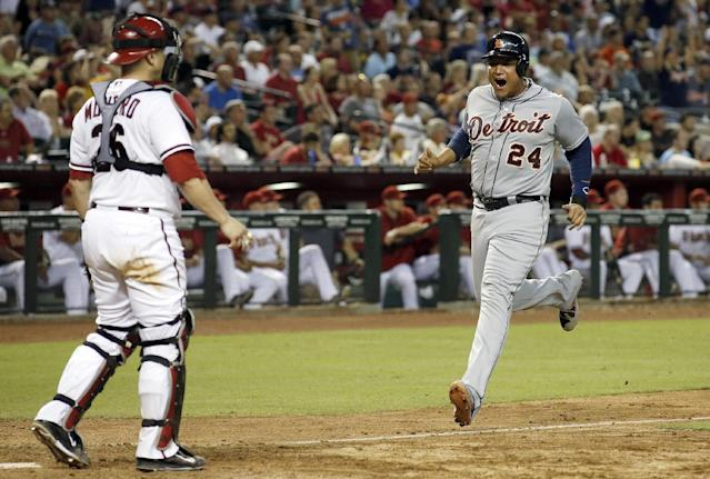Detroit Tigers' Miguel Cabrera (24) shouts in celebration as he comes in to score as Arizona Diamondbacks' Miguel Montero, left, looks on during the eighth inning of a baseball game on Tuesday, July 22, 2014, in Phoenix. (AP Photo)