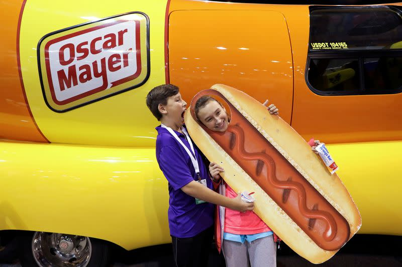 FILE PHOTO: DJ O'Keefe and his sister Dallas pose for a photo with the Oscar Mayer Weiner Mobile at the annual Berkshire Hathaway shareholder meeting in Omaha