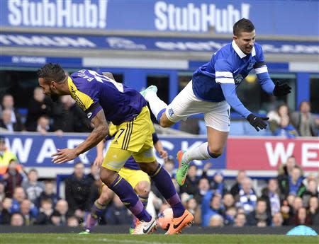 Everton's Mirallas challenges Swansea's Bartley during their English FA Cup fifth round soccer match at Goodison park in Liverpool, northern England