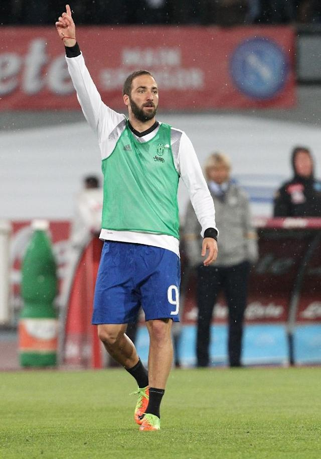 Gonzalo Higuain was treated to over a minute of uninterrupted whistling when he walked out at a stadium where he was once idolised (AFP Photo/CARLO HERMANN)
