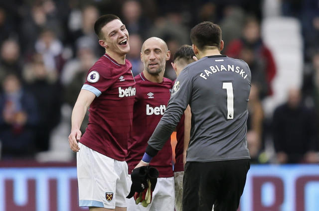 West Ham's Declan Rice, left, celebrates with West Ham goalkeeper Lukasz Fabianski, right, at the end of the English Premier League soccer match between West Ham United and Arsenal at London Stadium in London, Saturday, Jan. 12, 2019. Rice scored the goal in West Ham's 1-0 win. (AP Photo/Tim Ireland)