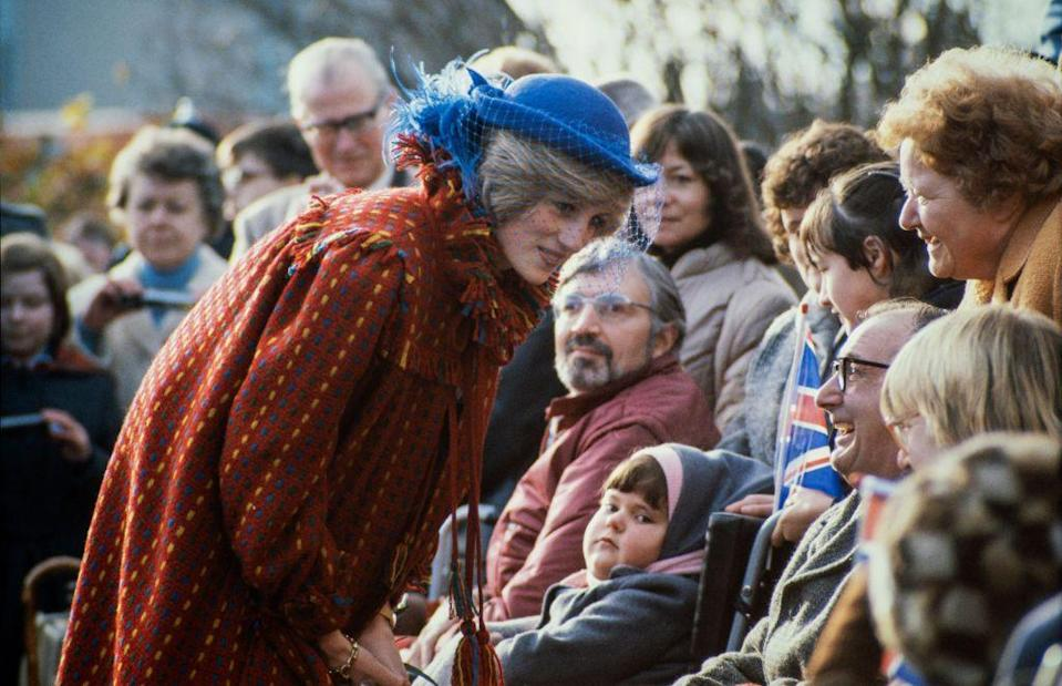 <p>Princess Diana leans in to chat with well-wishers during a visit to Wrexham, Wales in 1982. </p>