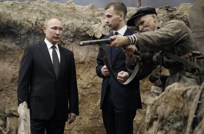 Russian President Vladimir Putin, left, visits the exhibition - 'Memory speaks. The road through the war' in St. Petersburg, Russia, Saturday, Jan. 18, 2020. Putin will atten events marking the 77th anniversary of the break of Nazi's siege of Leningrad. The Red Army broke the nearly 900-day blockade of the city on January 19, 1943 after fierce fighting. (AP Photo/Dmitri Lovetsky, Pool)