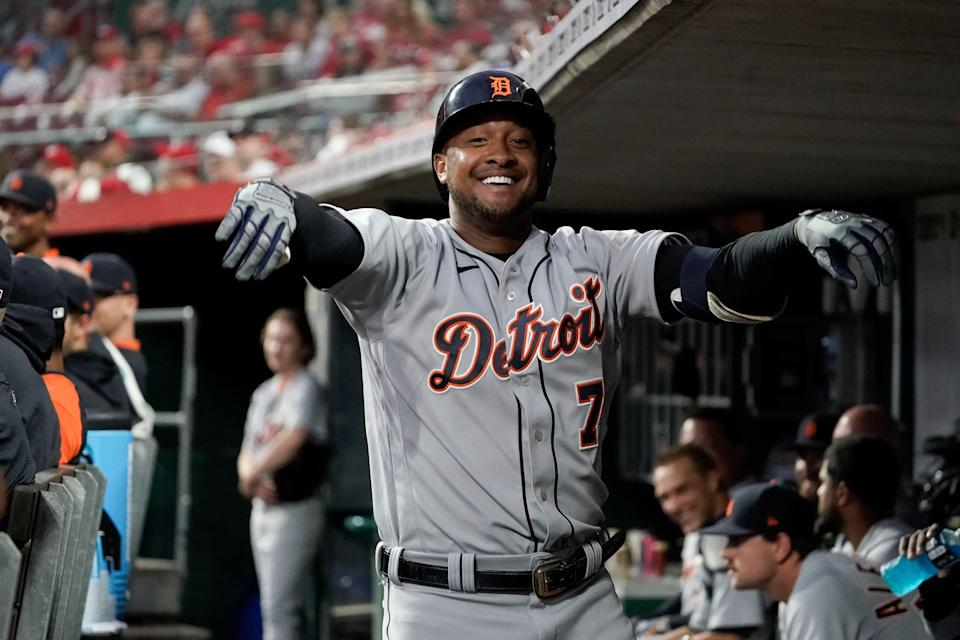 Detroit Tigers' Jonathan Schoop (7) celebrates in the dugout after hitting a solo home run during the third inning of a baseball game against the Cincinnati Reds, Friday, Sept. 3, 2021, in Cincinnati.