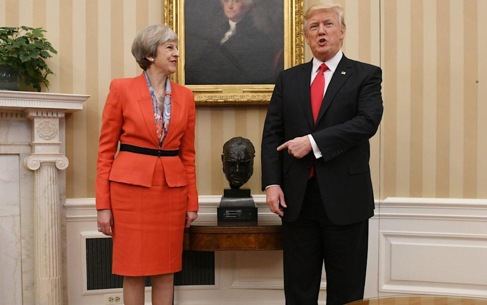 Prime Minister Theresa May meeting US President Donald Trump by a bust of Sir Winston Churchill in the Oval Office - Stefan Rousseau/PA