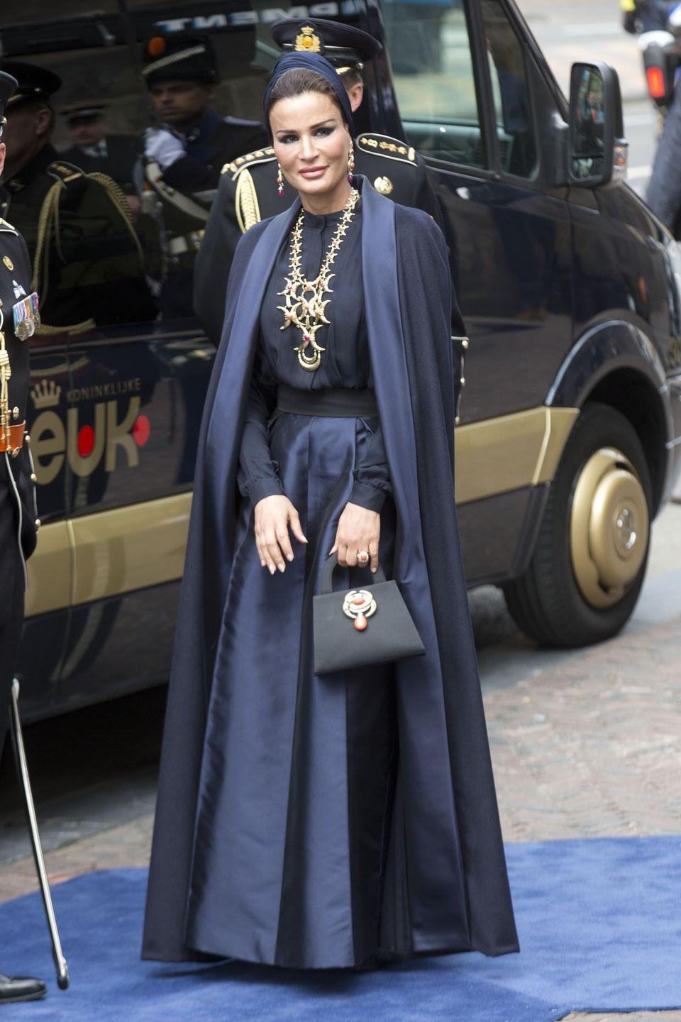 <p>Here, she's had a Valentino couture cape and dress customized, which she then accented with oversized David Webb jewelry. </p>