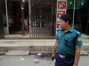 A policeman stands guard at the site in the Bangladeshi capital Dhaka where Nazimuddin Samad was hacked to death by four assailants, on April 7, 2016