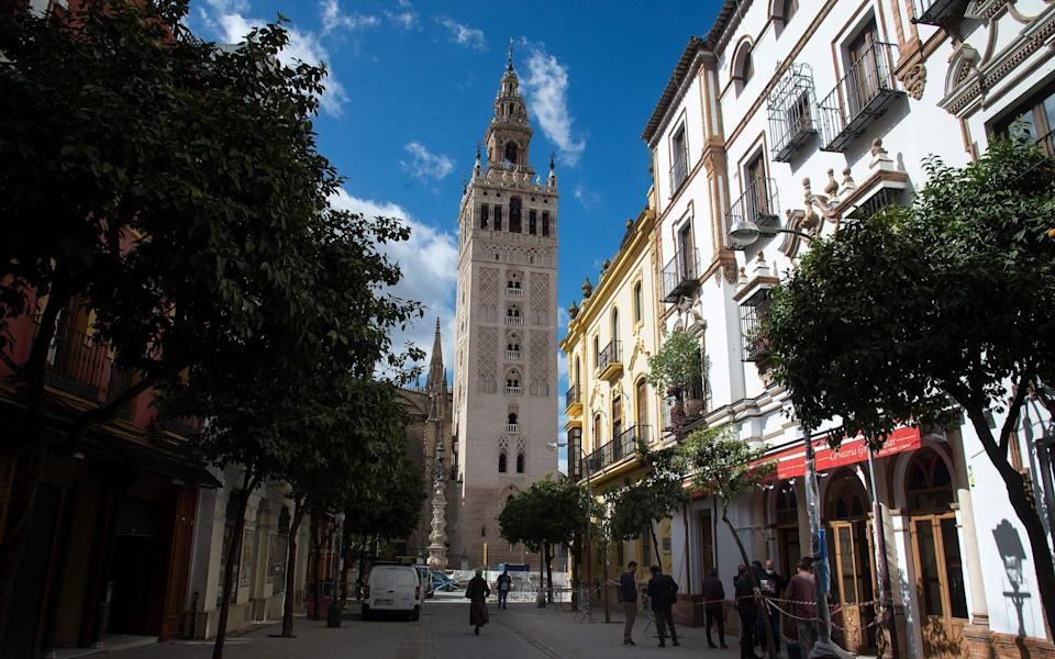 The bar sits in the shadow of the Giralda - AFP