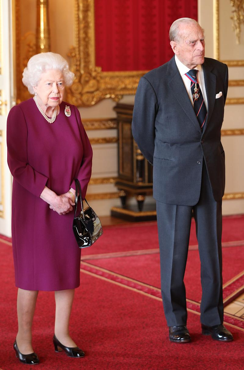 WINDSOR, ENGLAND - MAY 7: Queen Elizabeth II and Prince Philip, Duke of Edinburgh join members of the Order of Merit ahead of a luncheon at Windsor Castle on May 7, 2019 in Windosr, England. Established in 1902 by King Edward VII, The Order of Merit recognises distinguished service in the armed forces, science, art, literature, or for the promotion of culture. Admission into the order remains the personal gift of The Queen and is restricted to a maximum of 24 living recipients from the Commonwealth realms, plus a limited number of honorary members. (Photo by Jonathan Brady - WPA Pool/Getty Images)