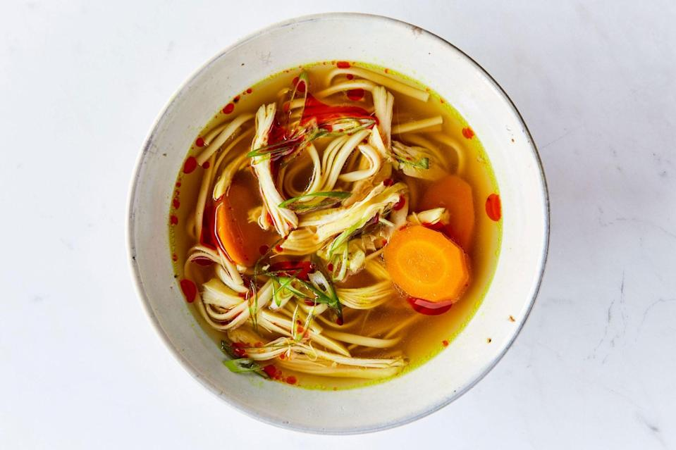 """Chicken noodle soup never gets old. If you don't have udon for this recipe, use rice noodles or regular old spaghetti. A small knob of fresh turmeric can replace the dried type. <a href=""""https://www.epicurious.com/recipes/food/views/turmeric-ginger-chicken-soup?mbid=synd_yahoo_rss"""" rel=""""nofollow noopener"""" target=""""_blank"""" data-ylk=""""slk:See recipe."""" class=""""link rapid-noclick-resp"""">See recipe.</a>"""