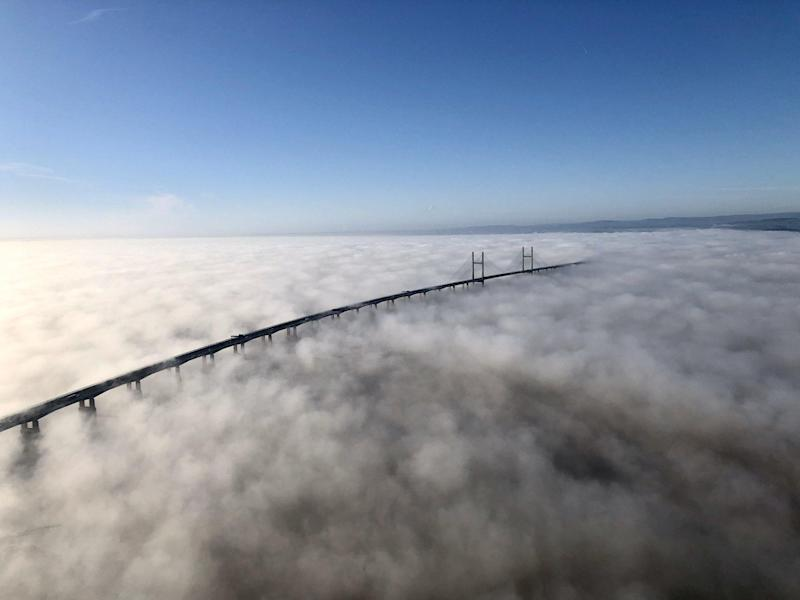 Aerial images captured by a National Police Air Service helicopter show the Severn Bridge, which links Wales and England, shrouded in fog, 21 January, 2020. The fog is believed to have been caused by a phenomenon known as temperature inversion: NPAS South West