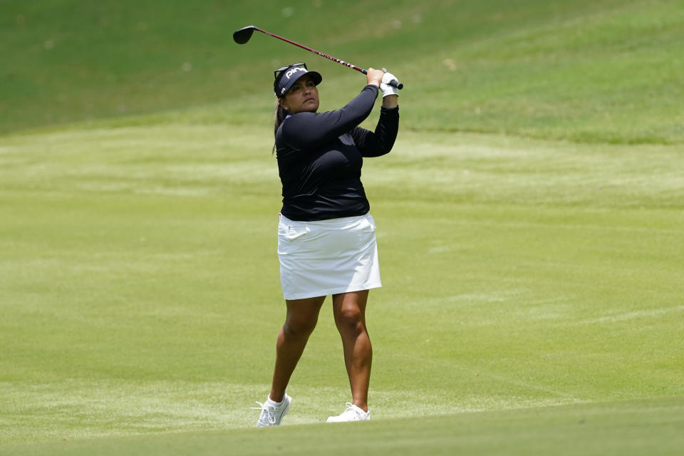 Lizette Salas of the U.S. watches her shot after hitting on the second hole fairway, during the final round of play in the KPMG Women's PGA Championship golf tournament Sunday, June 27, 2021, in Johns Creek, Ga. (AP Photo/John Bazemore)