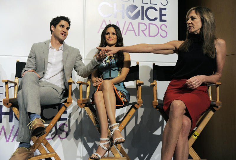 Actors Darren Criss, left, and Allison Janney, right, congratulate each other on their People's Choice nominations as fellow presenter Rachel Bilson looks on during the nominations for the 40th Annual People's Choice Awards at The Paley Center for Media on Tuesday, Nov. 5, 2013 in Beverly Hills, Calif. The show will be held on Jan. 8, 2014 at the Nokia Theater L.A. Live in Los Angeles. (Photo by Chris Pizzello/Invision/AP)