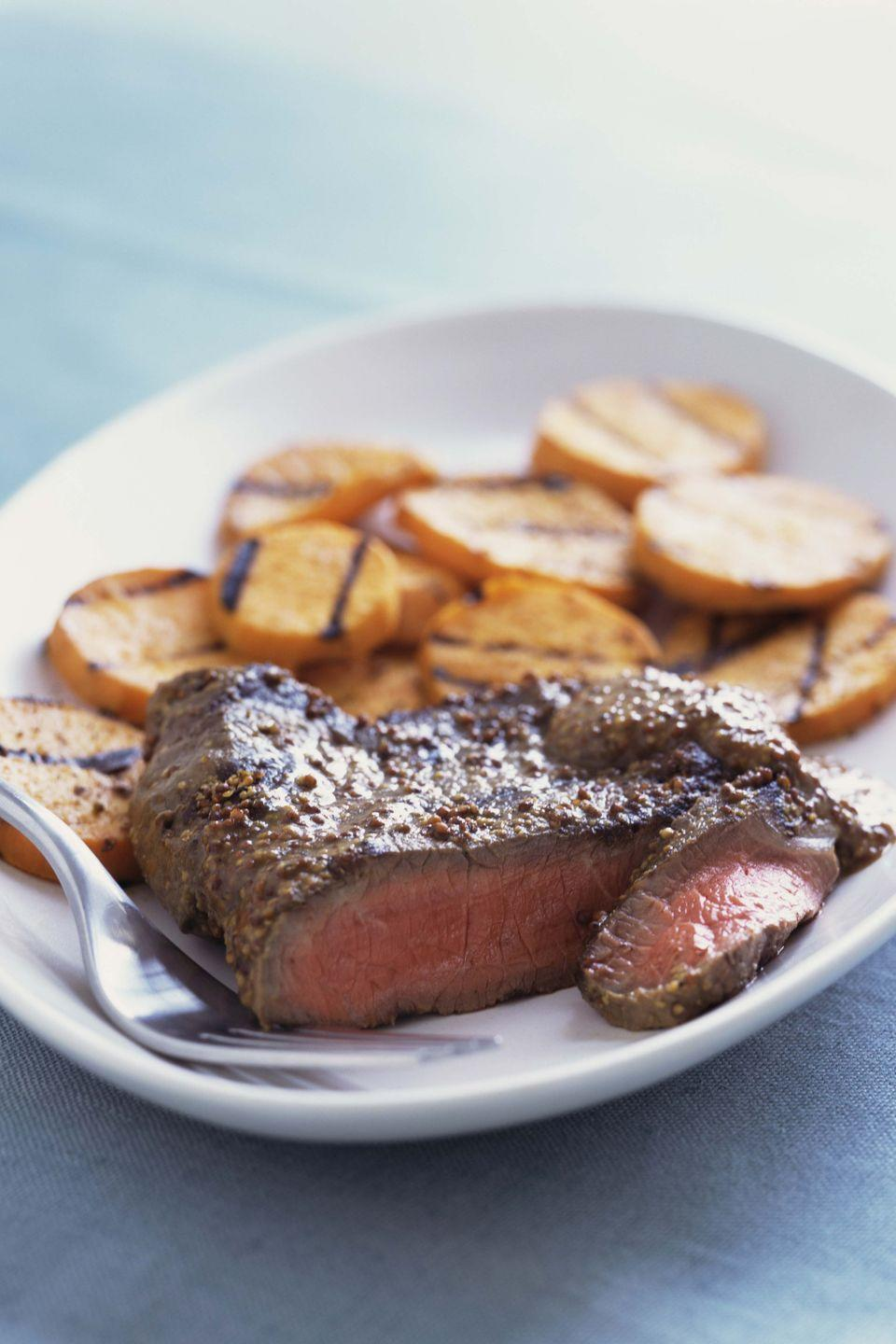 "<p>Serve 3 ounces broiled or grilled flank steak with 1 baked <a href=""https://www.goodhousekeeping.com/health/diet-nutrition/a48026/sweet-potato-nutrition/"" rel=""nofollow noopener"" target=""_blank"" data-ylk=""slk:sweet potato"" class=""link rapid-noclick-resp"">sweet potato</a> with 1 teaspoon butter; 1 cup steamed zucchini; and 1 1/2 cup berries. </p><p><strong>RELATED: <a href=""https://www.goodhousekeeping.com/food-recipes/healthy/g154/healthy-dinner-recipes/"" rel=""nofollow noopener"" target=""_blank"" data-ylk=""slk:100+ Best Healthy Dinner Ideas You'll Want to Make Tonight"" class=""link rapid-noclick-resp"">100+ Best Healthy Dinner Ideas You'll Want to Make Tonight</a></strong></p>"
