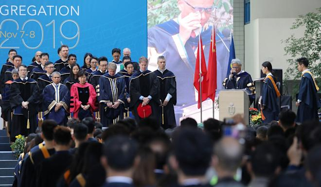Wei Shyy (right), president of the Hong Kong University of Science and Technology, announces the death of Chow Tsz-lok at a graduation ceremony on Friday. Photo: Dickson Lee