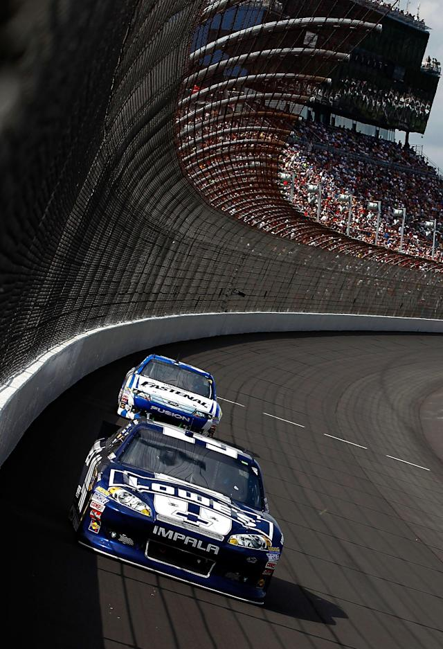 BROOKLYN, MI - JUNE 17: Jimmie Johnson, driver of the #48 Lowe's Chevrolet, leads Carl Edwards, driver of the #99 Fastenal Ford, during the NASCAR Sprint Cup Series Quicken Loans 400 at Michigan International Speedway on June 17, 2012 in Brooklyn, Michigan. (Photo by Jeff Zelevansky/Getty Images)