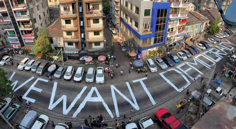 FILE PHOTO: A slogan is written on a street as a protest after the coup in Yangon