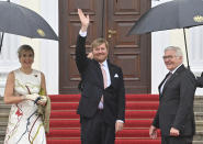 German president Frank-Walter Steinmeier, right, welcomes King Willem-Alexander of the Netherlands and Queen Maxima at the Bellevue palace ion Berlin, Germany, Monday, July 5, 2021. The Royals arrived in Germany for a three-day visit that was delayed from last year because of the coronavirus pandemic. (Bernd Von Jutrczenka/dpa via AP)