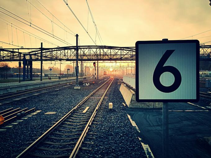 Number 6 By Railroad Tracks During Sunset