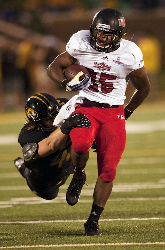 Arkansas State's David Oku, right, runs past Missouri's Andrew Wilson, left, during the first half of an NCAA college football game Saturday, Sept. 28, 2013, in Columbia, Mo. (AP Photo/L.G. Patterson)