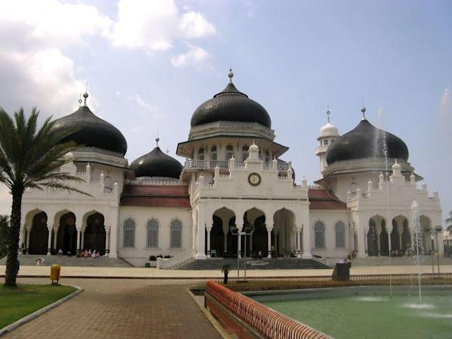 <b>BANDA ACEH, SUMATRA, INDONESIA:</b> The Baiturrahman Grand Mosque, Indonesia, was designed by an Italian architect and built by the Dutch colonial administration as a token of reconciliation following their destruction of an older mosque during the Aceh wars. It was completed in 1879. The mosque survived the 2004 Asian Tsunami that devastated most of the city of Banda Aceh.