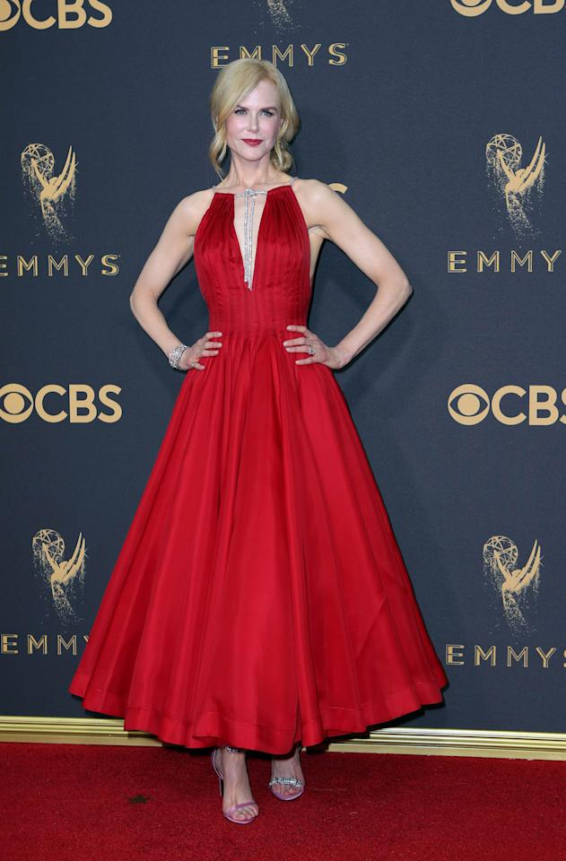 <p>Nicole Kidman, nominated for Best Actress in a Limited Series for her role in <em>Big Little Lies</em>, wore red to walk the red carpet. Her tea-length Calvin Klein dress featured a deep V-neck, which highlighted the large diamonds hanging from her neck. (Photo: Reuters) </p>