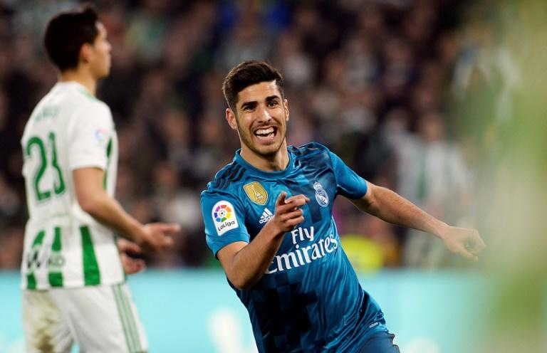 Man of the moment: Marco Asensio celebrates after scoring one of his two goals in Sunday's 5-3 win at Real Betis