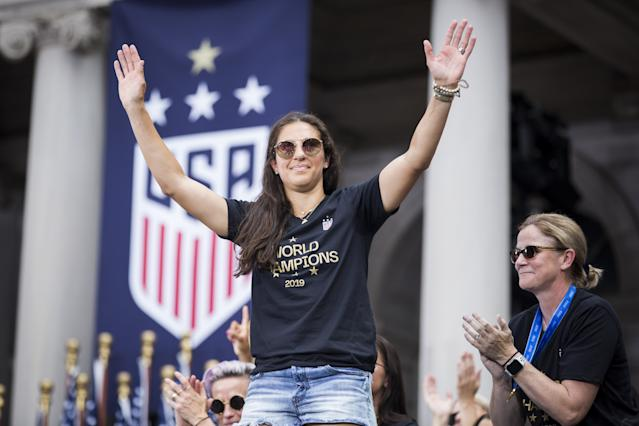 """<h1 class=""""title"""">U.S. Women's National Team World Cup Champions Ticker Tape Parade</h1> <div class=""""caption""""> Carli Lloyd celebrates during the ceremony on the steps of City Hall after the ticker tape parade down Broadway and through the Canyon of Heroes after Team USA's 2019 FIFA World Cup Championship title. </div> <cite class=""""credit"""">Ira L. Black - Corbis</cite>"""