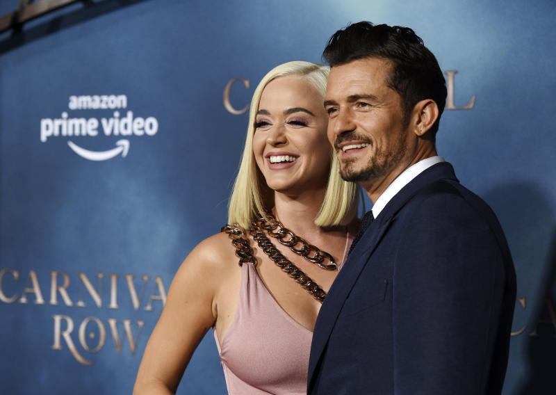 "Orlando Bloom, right, a cast member in the Amazon Prime Video series ""Carnival Row,"" poses with his girlfriend, singer Katy Perry, at the premiere of the series at the TCL Chinese Theatre, Wednesday, Aug. 21, 2019, in Los Angeles. (Photo by Chris Pizzello/Invision/AP)"